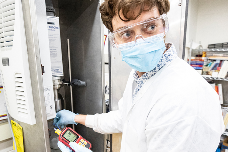 Doctoral student testing the properties of coating compound