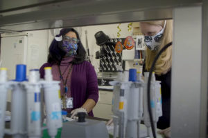 Ava Udvadia in lab with student