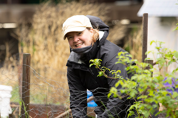 Kate Nelson working in a garden box
