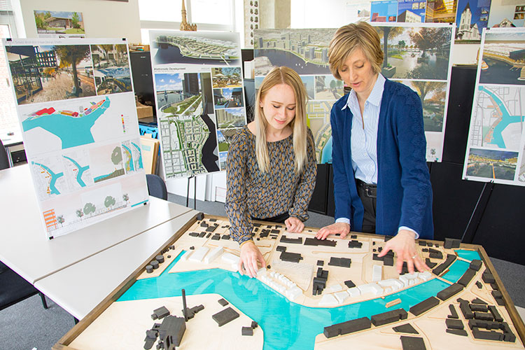 A professor and student work a scale model of Milwaukee