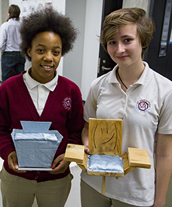 St. Joan Antida High School students Quannashia Nickelson (left) and Sarah Kopacz with the model chairs they built for Architecture 100.
