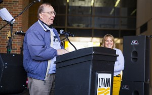 Jim Cheski, who drew the first Panther image adopted as UWM's mascot, addresses the crowd during the dedication of the Panther statue on Nov. 10, 2015 outside Golda Meir Library. (UWM Photo/Derek Rickert)
