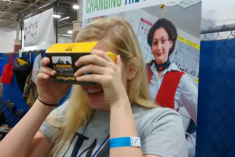 Molly Pinnekamp, a freshman in the College of Engineering and Applied Science at UWM and a member of the college's Society of Women Engineers, tours the engineering labs on campus using the college's new virtual-reality headsets. (UWM Photo/Chris Beimborn)