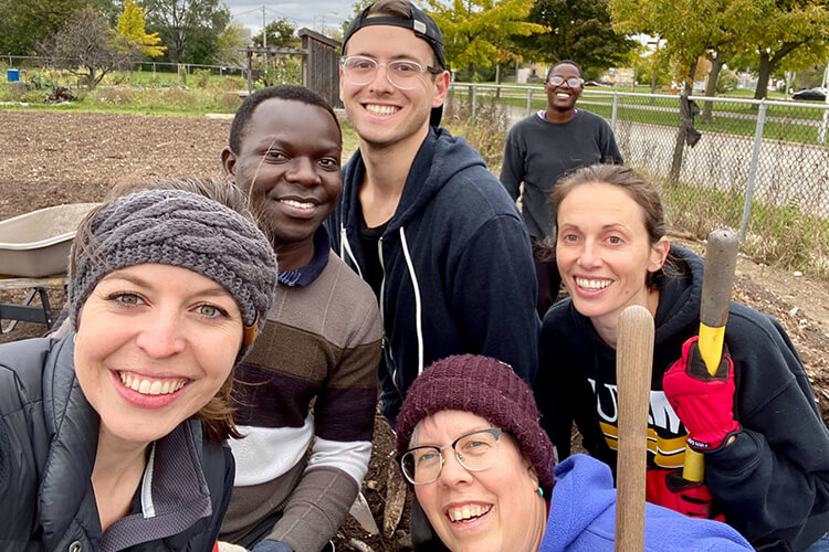 MSP Students and Faculty posing at community garden clean-up