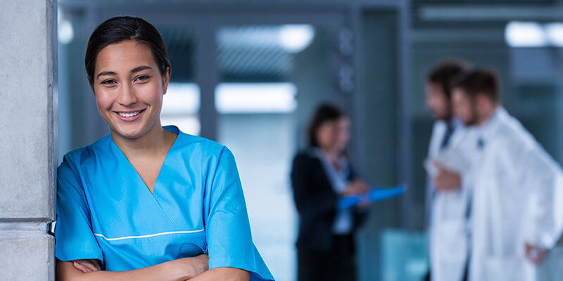Master of Nursing student RN to MN program student standing in hospital hallway