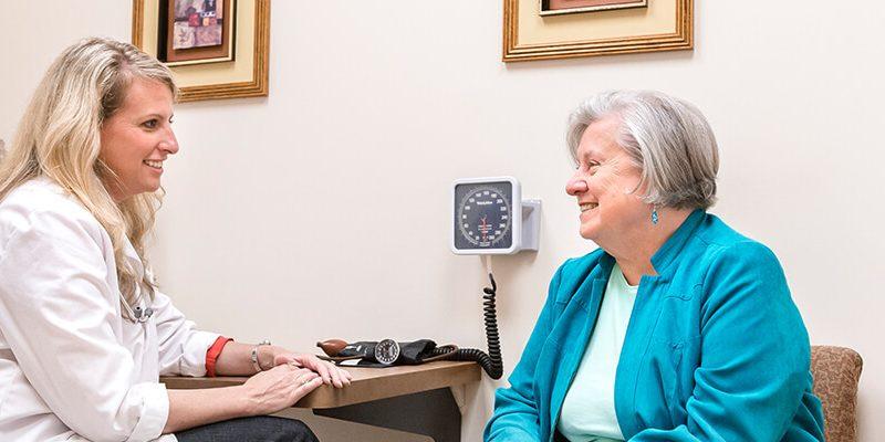 DNP, Doctoral Nursing Practice nurse meeting with adult woman patient