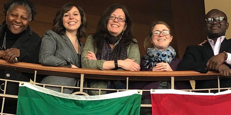 Global Studies, students by international flags