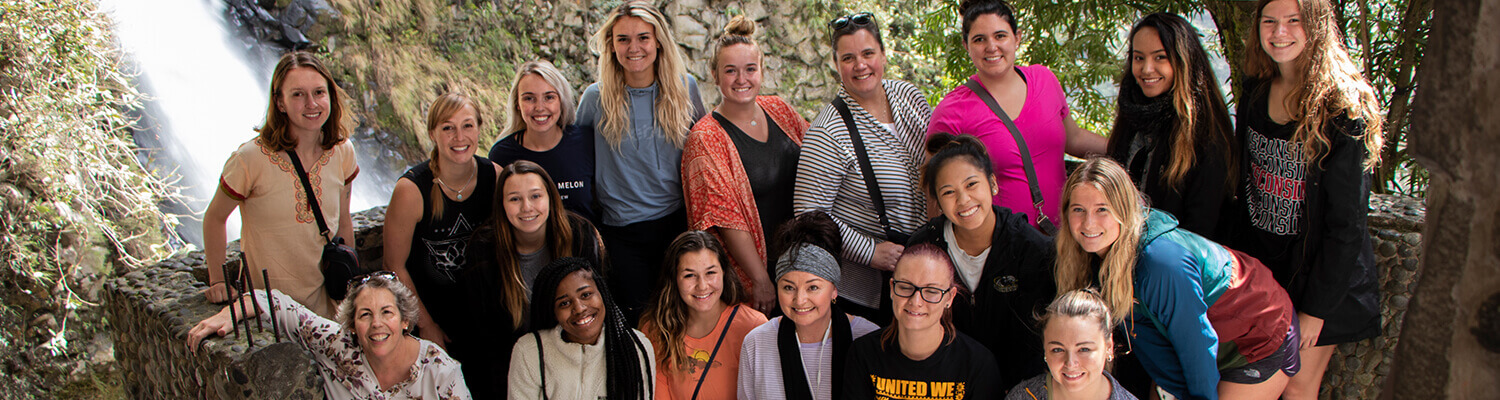 Group of Study Abroad students with Dr. Teresa Johnson and Dr. Heidi Luft by waterfall in Ecudaor