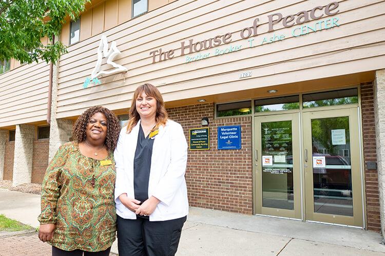 Vanessa Baldwin and Jessica Hertig outside of House of Peace