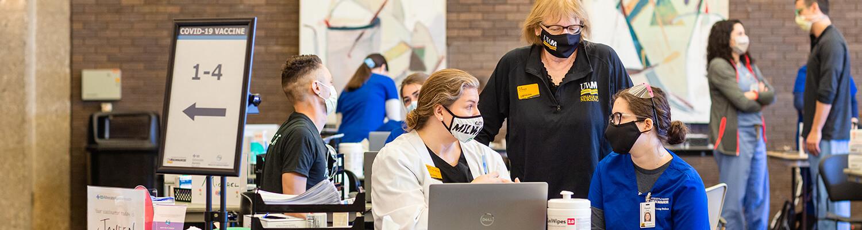 Mandy Sherrif, Dean Kim Litwack and Student at UWM and Aurora Advocate COVID 19 Vaccine Clinic