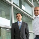 Sandeep Goplakrishnan and Zeyun Yu standing in hallway