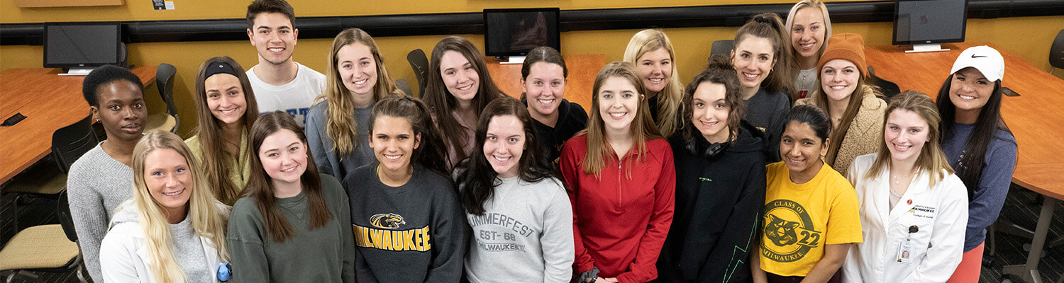 Students together in UWM Black and Gold classroom
