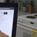 Photo of a user using HESTIA in a kitchen on an iPad