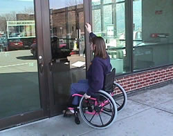 Photo depicting inaccessbility of a door for an individual in a wheelchair