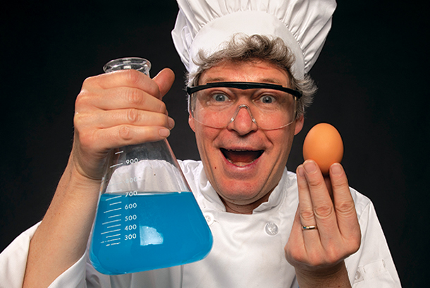 Science chef holding beaker and egg