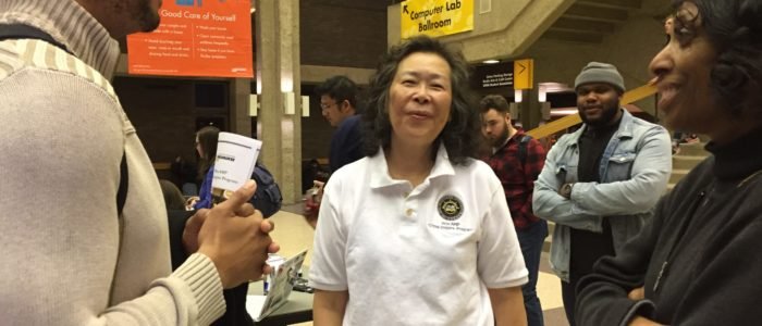 WiscAMP Staff Linda Huang helps students