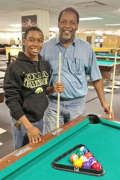 Joel Harris plays pool