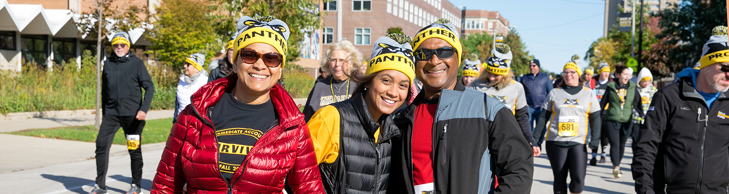 UWM student with parents at Panther Prowl
