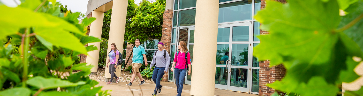 UWM students walking outside together