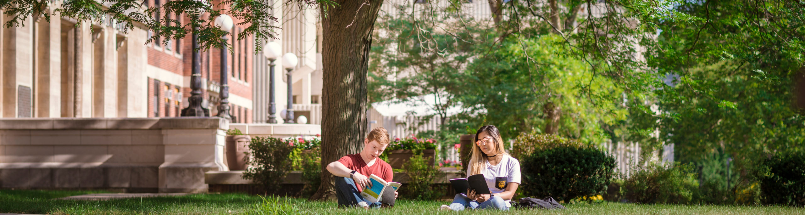 UWM students reading books outside