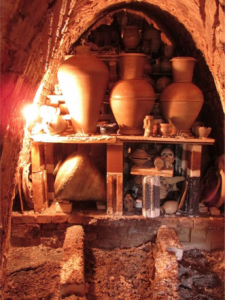 wood fired kiln with pots and various other items on shelves
