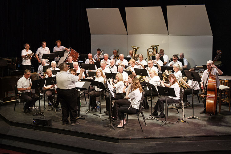 UWM at Waukesha Symphonic Band performs on stage