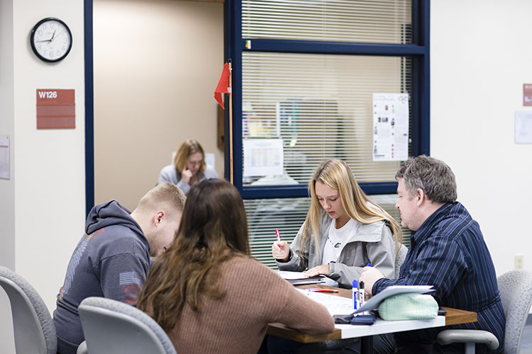 UWM at Waukesha students work with tutor in Academic Success Center on campus.