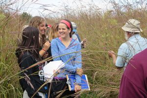 Students talk during a research trip at the field station.