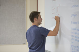student at white board